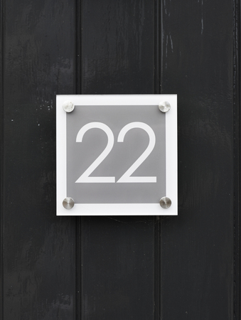 House number 22 on wooden wall happy new home moving away modern by number twenty two Banco de Imagens
