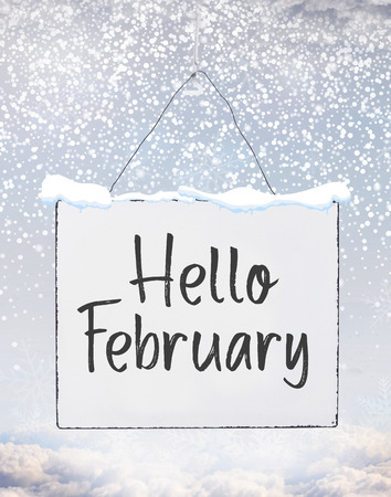Hello February text on white plate board banner with cold snow flakes qoute