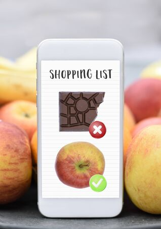 Phone with shopping list healthy vs unhealthy  dieting