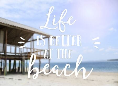 Text life is better at the beach summer quotes with beautiful sea background with wooden beach house Banco de Imagens