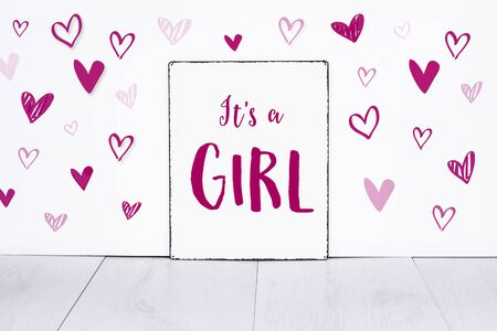 It's a girl new born baby text on sign board with cute little pink hearts on white background