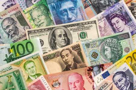 Foreign currency banknotes are arranged for a photograph