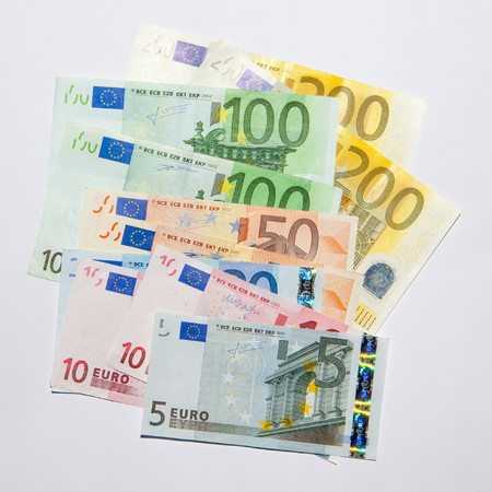 Euro bills arranged for a photograph