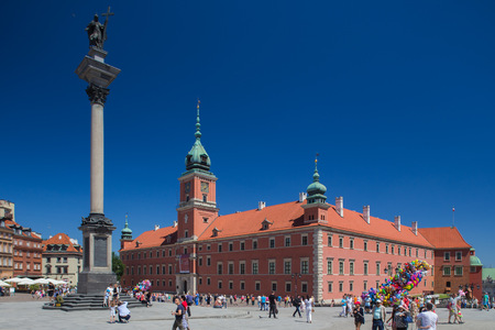 Warsaw, Poland - June 6, 2015 - A general view at the Warsaw Old Town - Royal Castle and Sigismunds Column. Redakční