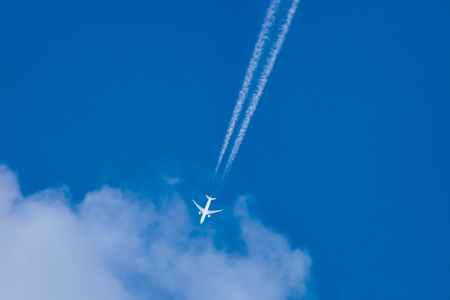 blu sky: A passenger airplane on the blu sky seen from below Stock Photo