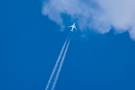 blu: A passenger airplane on the blu sky seen from below Stock Photo