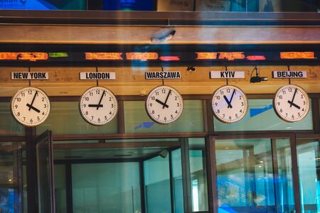 Poland, Warsaw, August 17, 2018. Clocks display time from various time zones at Warsaw Stock Exchange WSE, GPW) in Warsaw, Poland Publikacyjne