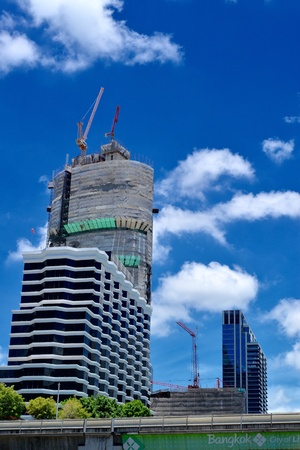 construction: Building under construction in the city,at daytime and clear sky. Stock Photo