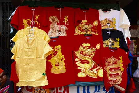 clothes: Chinese clothes, red and golden for Chinese New Year.