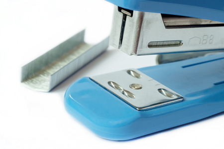 close up of blue stapler office supplies and staple