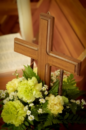 green cross: wood cross with beautiful green flowers Stock Photo