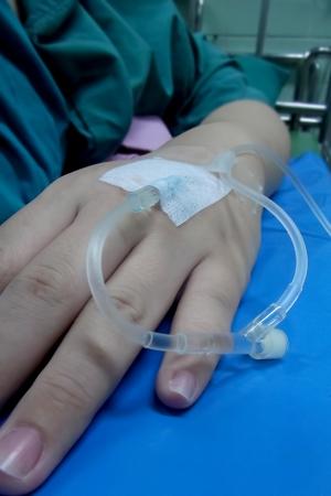 female catheter: IV tube put in asian female hand in hospital