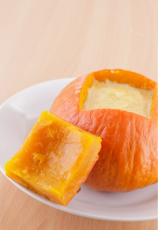 Egg custard in orange pumpkin photo
