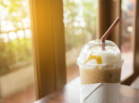 lighting background: iced coffee and sun lighting in morning with blurred background