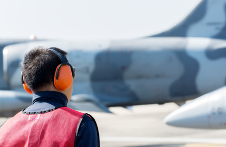 ear muffs: man use ear protection muffs on working
