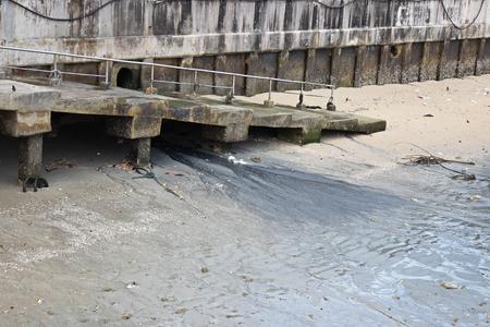 sewage: Drain sewage into the sea, damaging the environment. Stock Photo