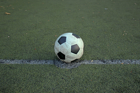 put: Football put in artificial turf. Stock Photo