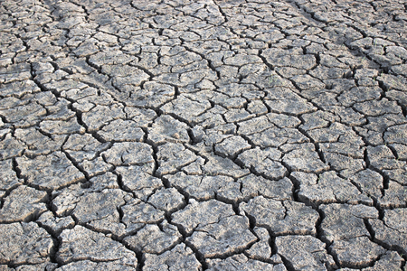 misery: Dry soil cracking nature texture background Stock Photo