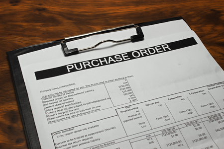 Purchase order form on wooden table Standard-Bild
