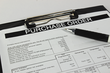 purchase: Purchase order form with pen