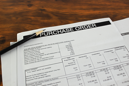 purchase: Purchase order form on wooden table Stock Photo