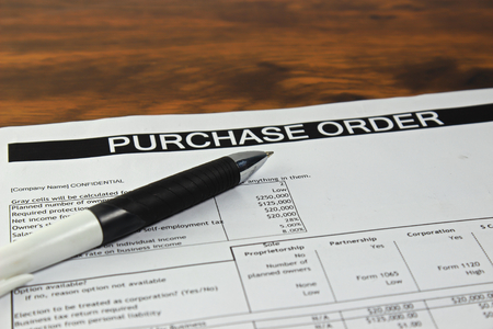 purchases: Purchase order form with pen
