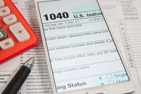 federal tax return: US tax form 1040 taxation concept