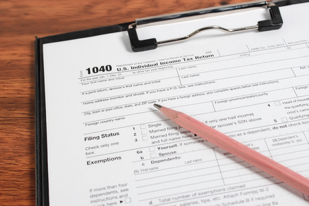 taxation: US tax form 1040 taxation concept