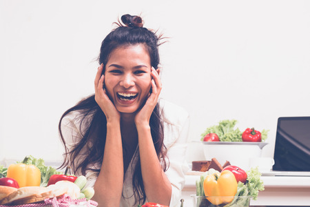 happy Asian woman in kitchen Stock Photo