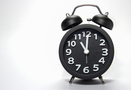 alarmclock: Black alarm clock Stock Photo