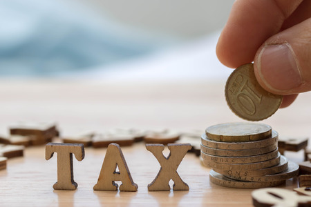 Tax Concept with wooden letters