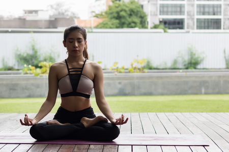 sexy asian woman: Attractive woman Playing yoga For her good health