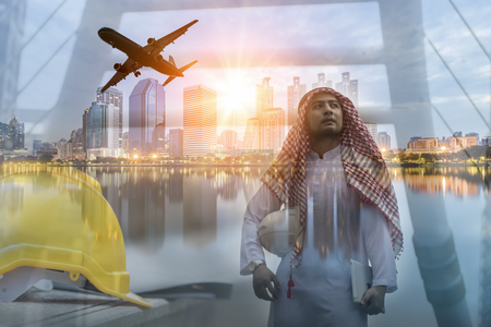thobe: Double exposure of Engineers Arabian and Cityscape and sunset at evening time.for business concept background Stock Photo