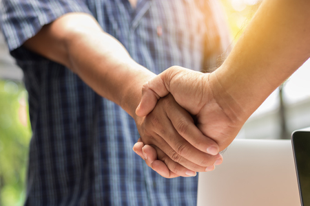 Close up of handshake for business success concept