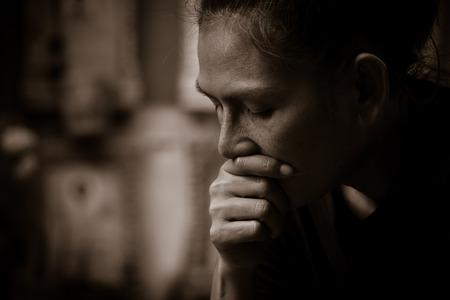 Sad Asian wonab in black and white