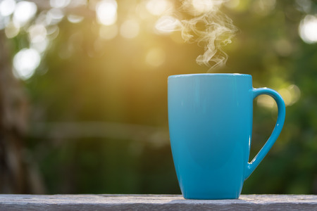 A cup of coffee in bokeh background
