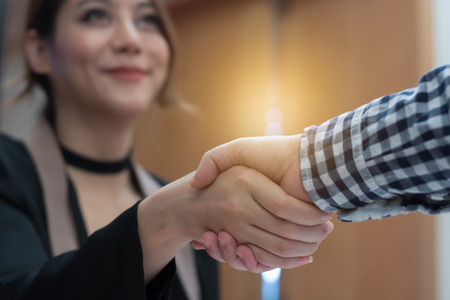 Young businesswoman make handshake with a businessman in succes business concept Stock Photo