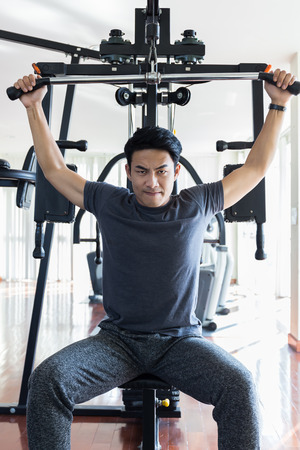 Handsome man are exercising in the gym. To be healthy with the lifestyle of the new generation. Stock Photo
