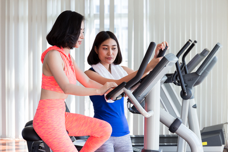 Close up of happy Asian women exercising in the gym for good healthy