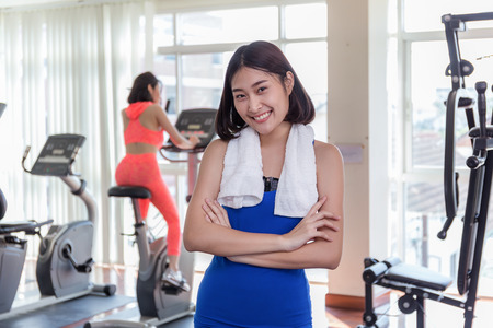 Close up of happy Asian woman exercising in the gym for good healthy