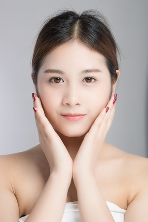 attractive beautiful asian woman skin care on white background