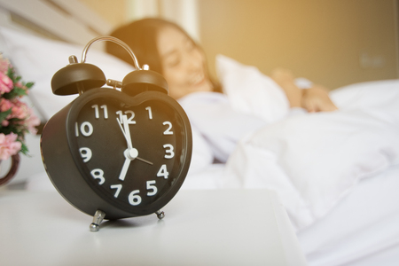Alarm clock in the bedroom Stock Photo