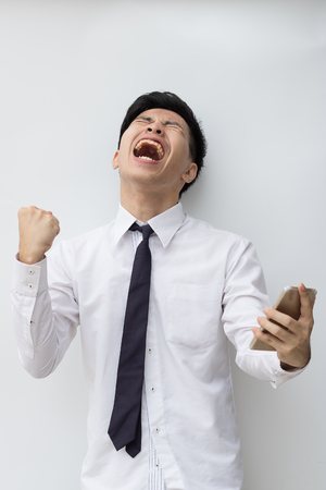Happy business man success story in his business Stock Photo