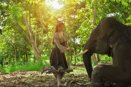 Portrait art of beautiful women and elephants in nature