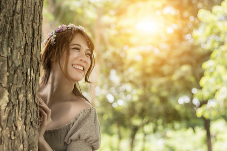 Happy beautyful Asian woman are smiling and fresh in plublic park. Stock Photo