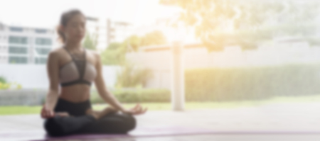 Blurred image for background of Attractive woman Playing yoga For her good health