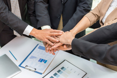 group of business person meetin and brainstrom.Hands were a collaboration concept of teamwork for success business concept.