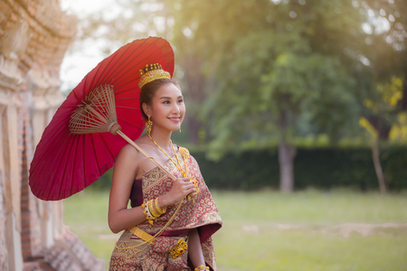 Beautiful Thai woman wearing Thai traditional dress.