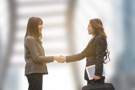 Success business woman handshake after deal complete