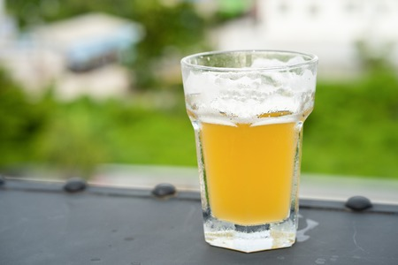 Beer glass on bokeh background Stock Photo
